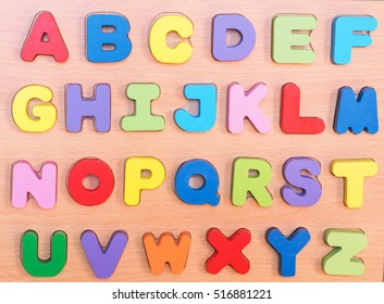 Colorful wooden letters A-Z sequentially on block plank