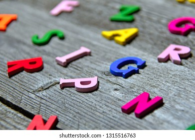 colorful wooden letters on old wooden board