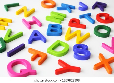 Colorful wooden letters on white background