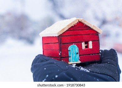 colorful wooden model home in the snow stay at home