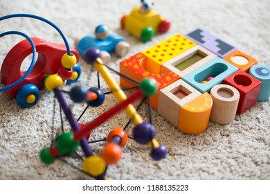 Colorful wooden, natural toys for small children. Kids playthings, including blocks and cars.