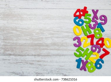 colorful wooden numbers on a old wooden background