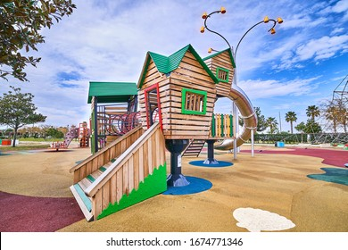 Colorful wooden playground in a kindergarten park for playing kid time