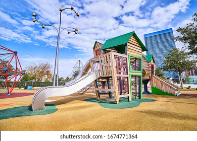 Colorful wooden playground with slide in a children park for playing time outdoor