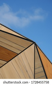 A colorful wooden roof and a blue sky