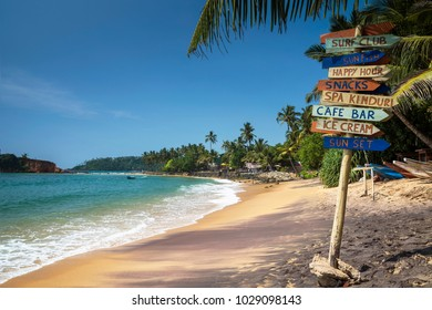 Colorful wooden sign at the beach in Mirissa, southern province, Sri Lanka
