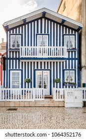 "Colorful wooden striped facade of a typical Portuguese house at Aveiro, ""portuguese Venice"", 10th Century city. old homes and houses in historic neighborhood, Portugal."