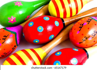 colorful wooden toy maracas music percussion instrument closeup as a background picture