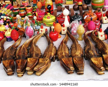 Colorful wooden toys and articles on display.