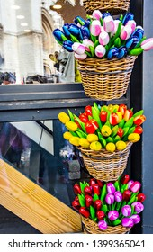 Colorful wooden tulips in the wicker baskets, souvenirs from Benelux counties, Antwerp, Belgium