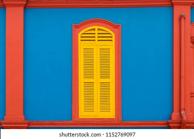 Colorful wooden window Colonial style architecture building in Little India, Singapore City