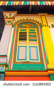 Colorful wooden window Colonial style architecture building in Little India, Singapore City.