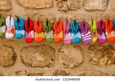 Colorful wool slippers for sale by street vendor, Midyat, Eastern Anatolia, Turkey