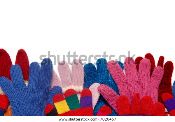 Colorful woolen gloves on a white background