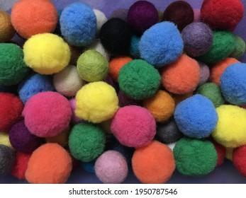 Colorful woolen pompoms and felt balls