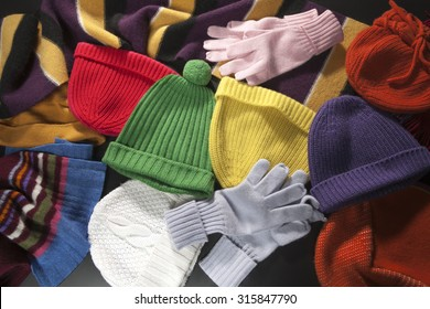 Colorful woolen scarf, hats and gloves background