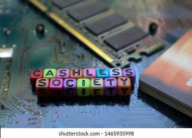Colorful word Cashless Society on circuit of mother board computer and credit card.Concept of cashless society for business. technology for new financial for background.