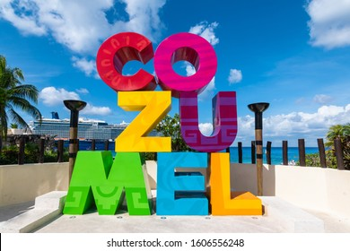 Colorful word sign along the street in Cozumel, Mexico.  Cruise ship on the background.