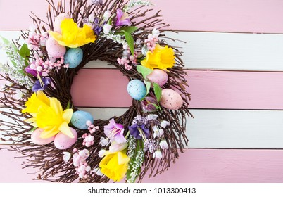 Colorful wreath with flowers and easter eggs
