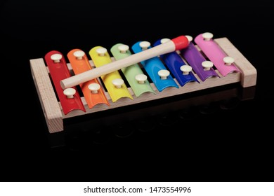 Colorful xylophone on black background