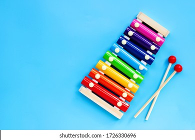 Colorful xylophone on yellow background.