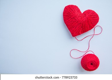 Colorful yarn ball isolated on white background. Space for text. Red heart like a symbol of love. Hobby concept.heartbeat,feelings, romance concept