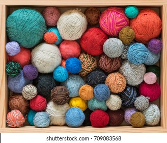 Colorful yarn balls in wooden box