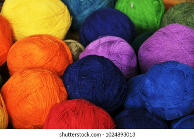 Colorful yarn in a basket.