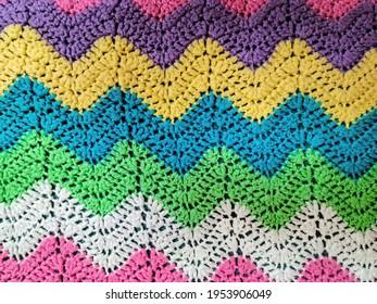 Colorful yarn in crochet zigzag pattern background
