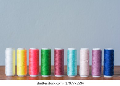 Colorful yarn on spool, yarn on tube, cotton, wool, linen thread,Color sewing threads on white background, top view