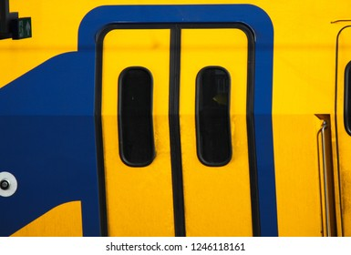 Colorful yellow and blue dutch railway wagon (Nederlandse spoorwegen), Utrecht, Netherlands