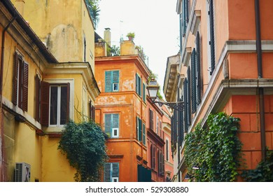 Colorful yellow and orange buildings on a street of Rome, Lazio, Italy