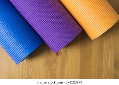 colorful of yoga mat on wood table