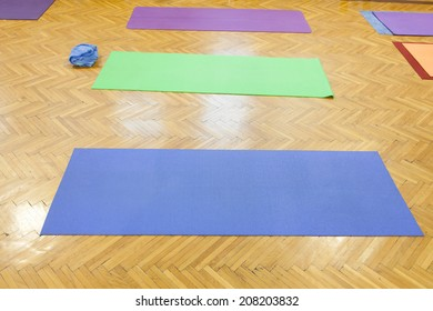 colorful yoga mats in studio