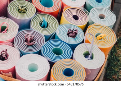 colorful yoga mats,sale of yoga mats. Film effect, unfocuset