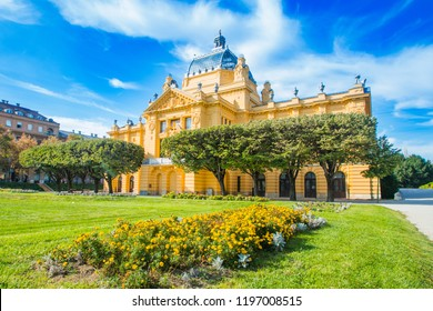 Colorful Zagreb, Croatia, art pavilion and beautiful flowers in park in summer day, classic 19 century architecture
