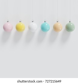 Colorfull christmas ball Ornaments hanging on white background. minimal christmas concept.