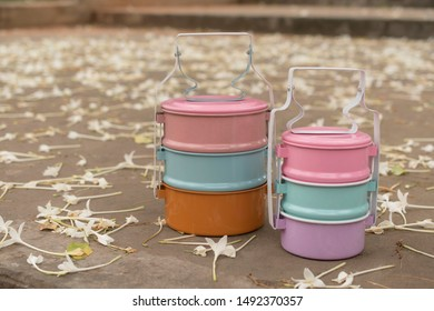 colorfull enamelled tiffin food on floor have flower metal