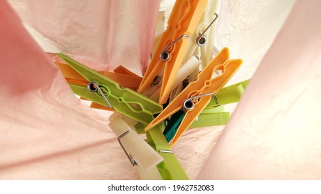 colorfull plastic clothespin inside the plastic bag
