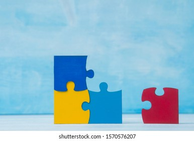 Colorfull puzzles piece on blue background. World Autism Awareness Day Concept