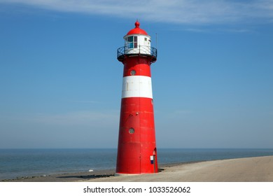 Colorfull red lighthouse to guide the ships at sea