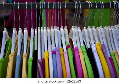 colorfull shirts in a row on the market