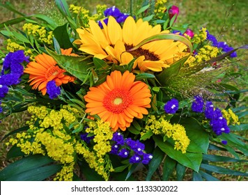 Colorfull summer bouquet with a sunflower in the middle