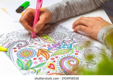 Coloring book for adults. Drawing as a hobby. Concentration activities to relieve stress.