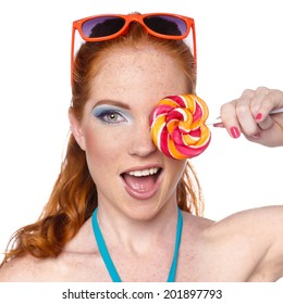 Coloring Hairstyle. Beauty Girl Portrait holding Colorful lollipop. Fashion makeup. Isolated on white background. Colorful Studio Shot of Funny Woman.