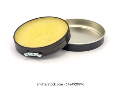 Colorless transparent wax for shoes. Open round container on a white background Shoe care concept