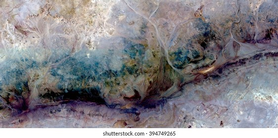 colors cracks in the stone, abstract photography of the deserts of Africa from the air, bird's eye view, abstract expressionism, contemporary art, optical illusions,