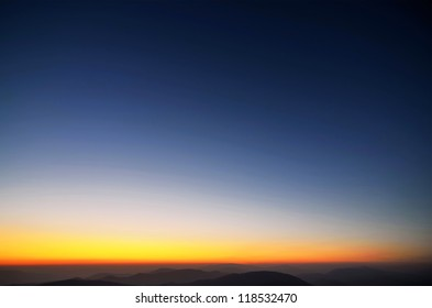 Colors of evening sky above the mountains and ridges