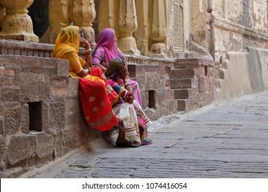 Colors of India. Women wearing sari in the fort of Jodhpur,Rajashtan