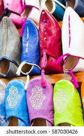 Colors of Marrakesh on sophisticated handmade traditional leather slippers at old medina souk, Morocco